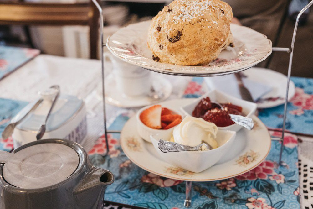 Fruit scones, jam and cream, known as afternoon tea in UK, serve