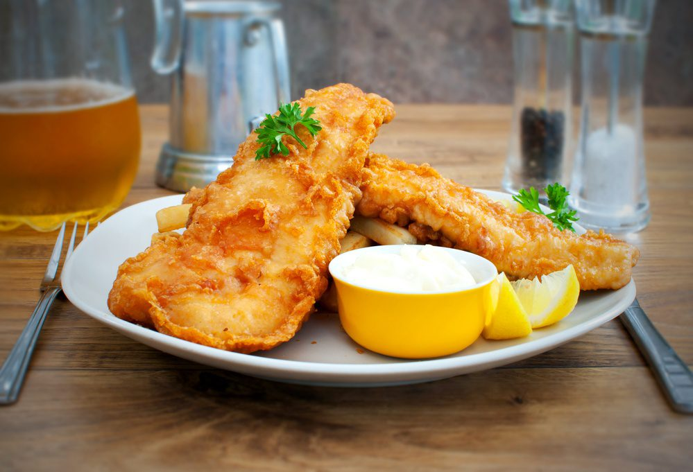 Traditional english fish and chips takeaway meal